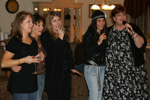 Debbie, Shirley (my mom), Tricia (my sister), me and Pat singing Teddy Bear Song.