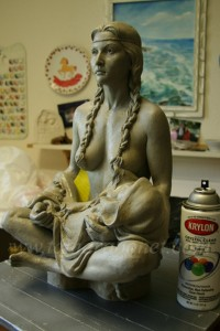 Spray the original clay sculpture with a sealer.