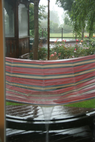 Spring rain drains off our hammock.