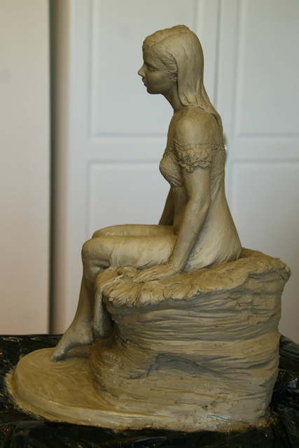 Side view of woman sculpture.