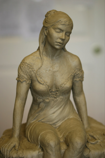 Closeup of woman sculpture.