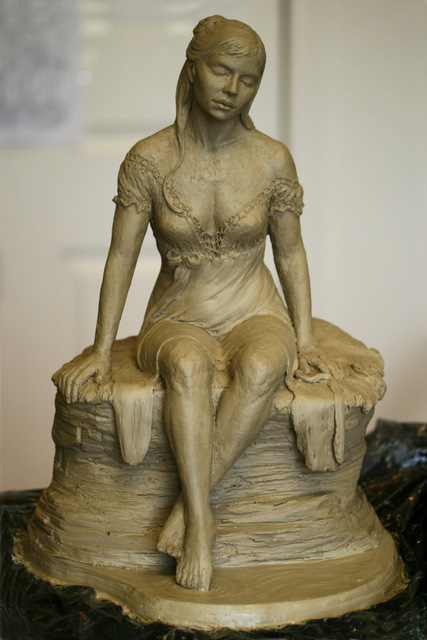 Front view of woman sculpture.