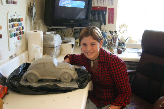 Tristyn with the unfired wet clay ceramic Volkswagon bug.
