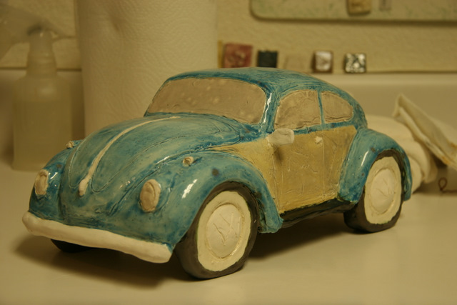Volkswagon ceramic bug without the chrome painted.