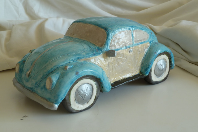 Side view of Volkswagon bug.