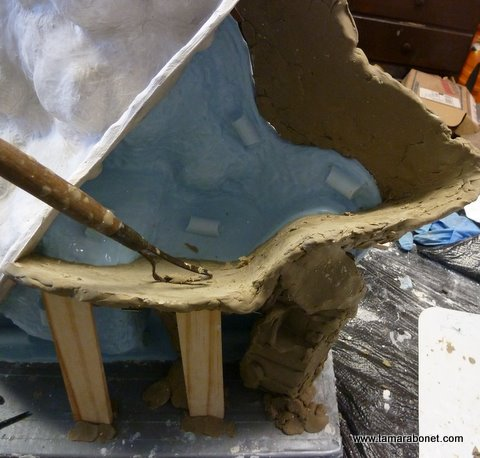 Use a variety of tools to clean and smooth clay.