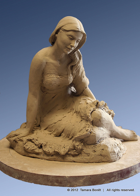Rough clay sketch of lady showing contemplation.