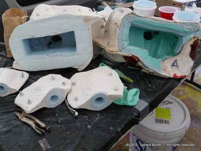 Finished mold in light blue next to damaged mold.