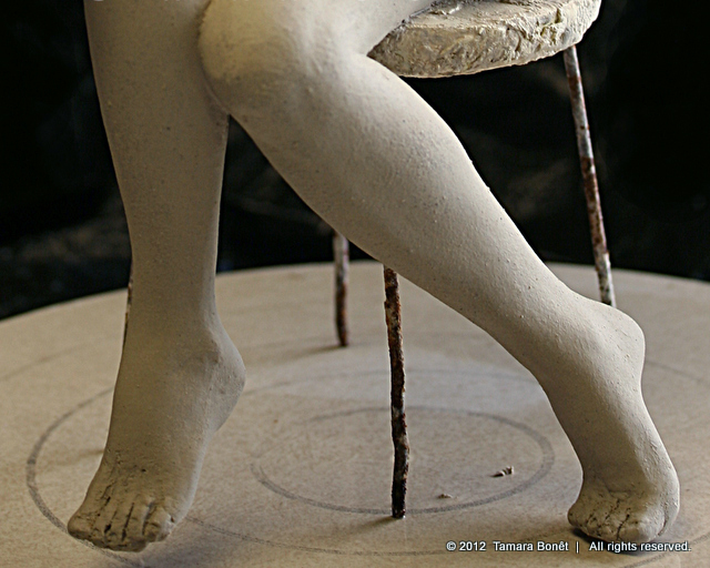 Unfinished quick sketch clay sculpture legs.