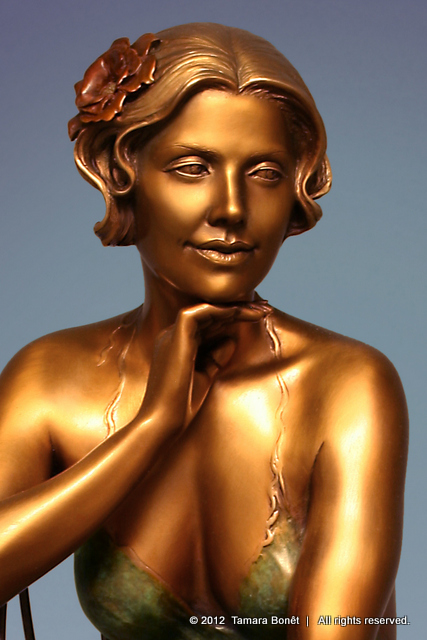 Closeup view of face of bronze Garden Reverie.
