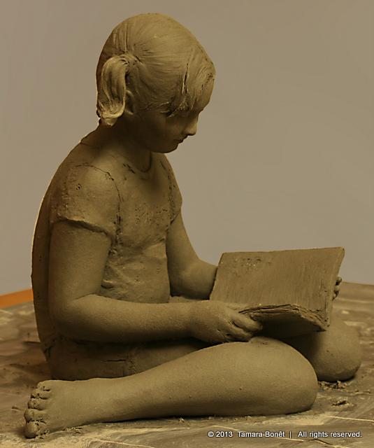 Pretty tom boy little girl reading a story.